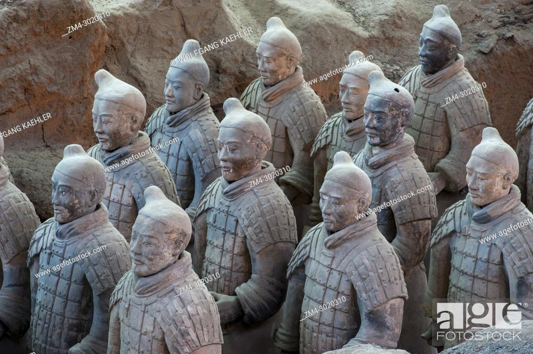 Stock Photo: View of the Terracotta Army in the Terracotta Warriors and Horses Museum, which is displaying the collection of terracotta sculptures depicting the armies of.