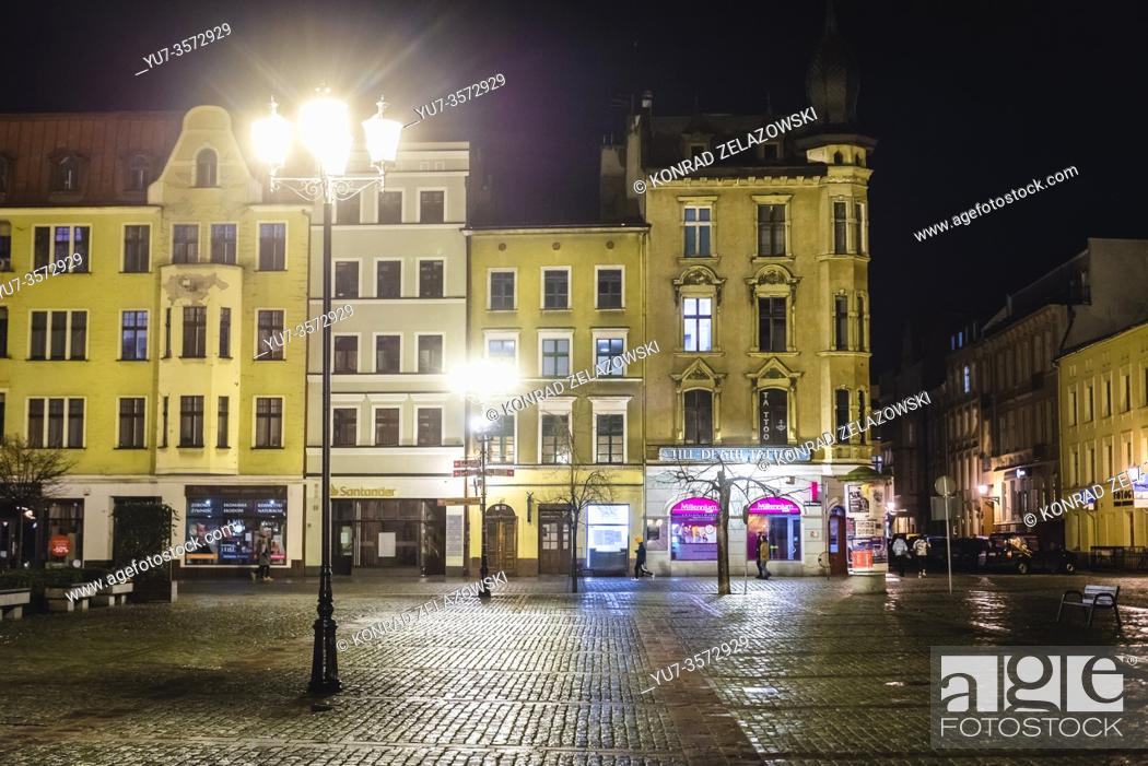 Stock Photo: Houses around New Town Market Square in eastern part of Old Town Complex of Torun city, Kuyavian Pomeranian Voivodeship of Poland.