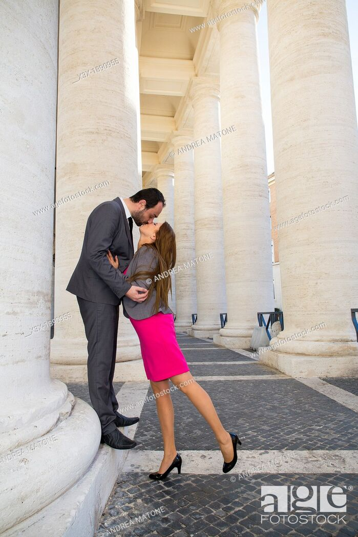 Stock Photo: Couple kissing in the colonnade of Saint Peter's cathedral Vatican Rome Italy.