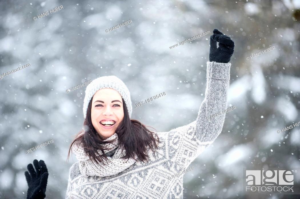 Stock Photo: Young woman having fun in snow.