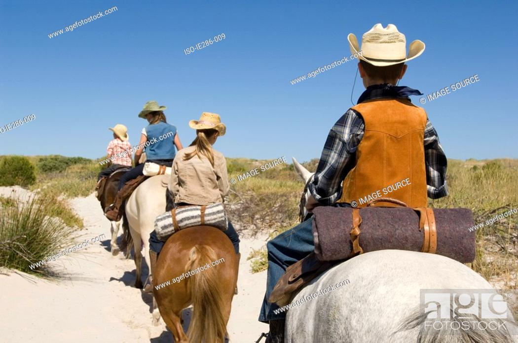 Stock Photo: Friends riding horses.