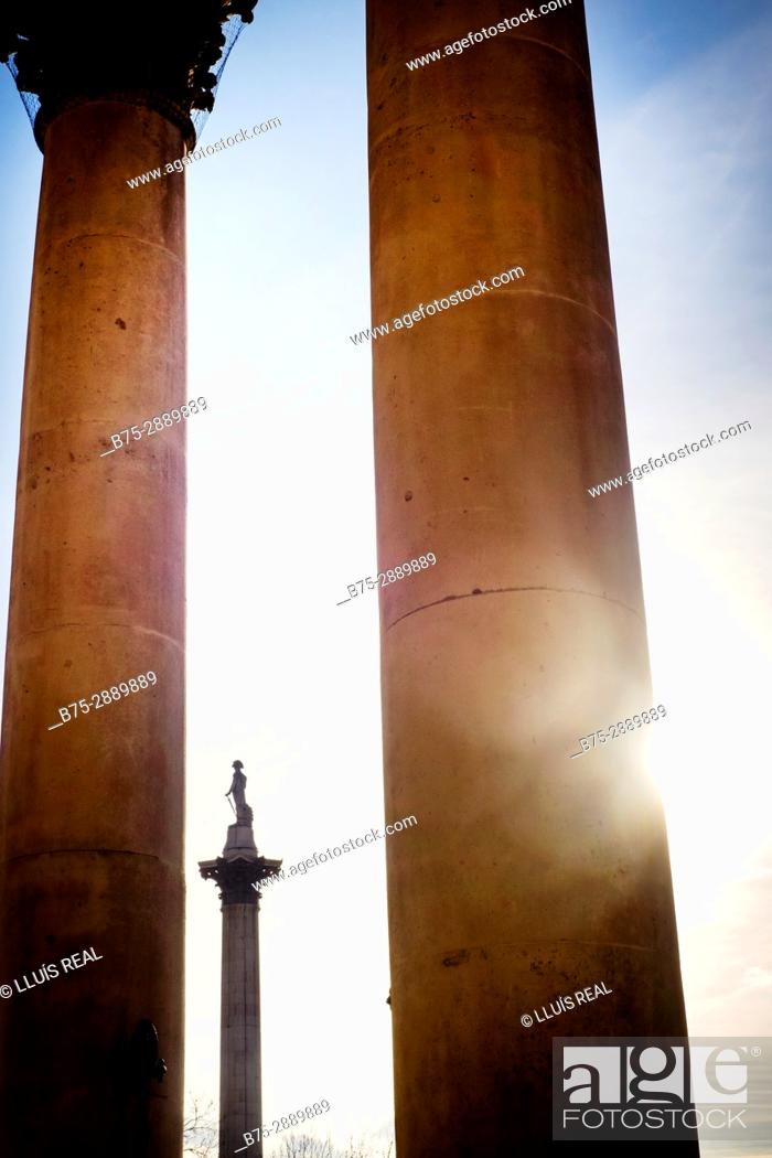 Stock Photo: Nelson's Column seen through the columns of St. Martins ch, Trafalgar Square, London, England.