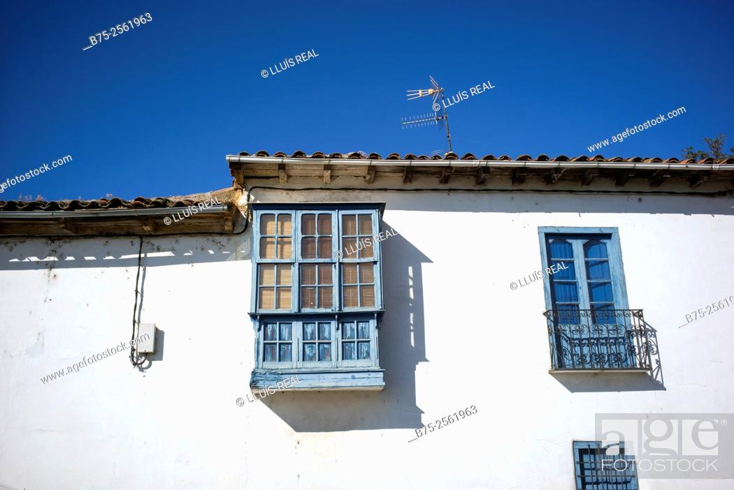Stock Photo: Facade with balcony, bowindow and typical window of a village house. Province of Leon, Camino de Santiago, Spain.