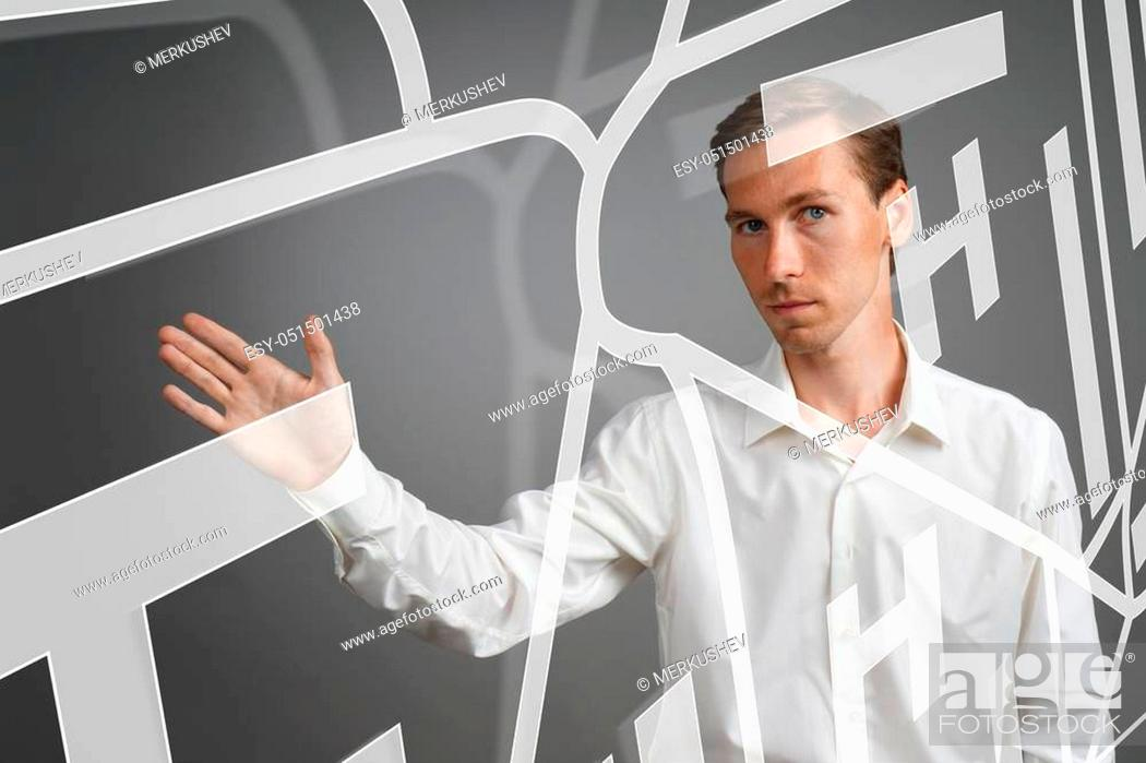 Stock Photo: Future technology, navigation, location concept. Man showing transparent screen with gps navigator map. Grey background.