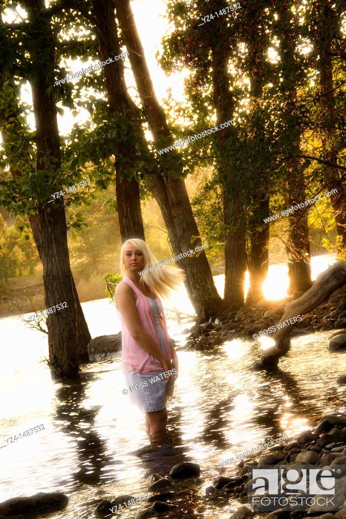 Stock Photo: Young blonde woman outdoors in Spokane, Washington, USA.