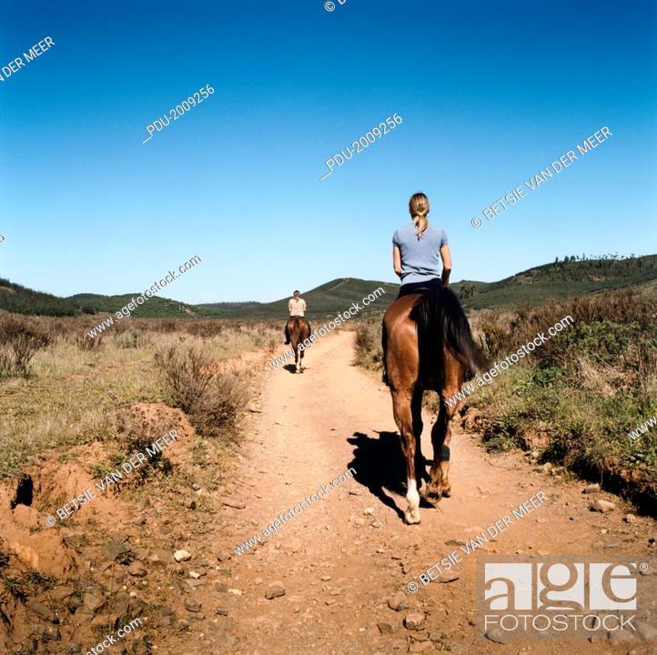 Stock Photo: Women Riding Horses.