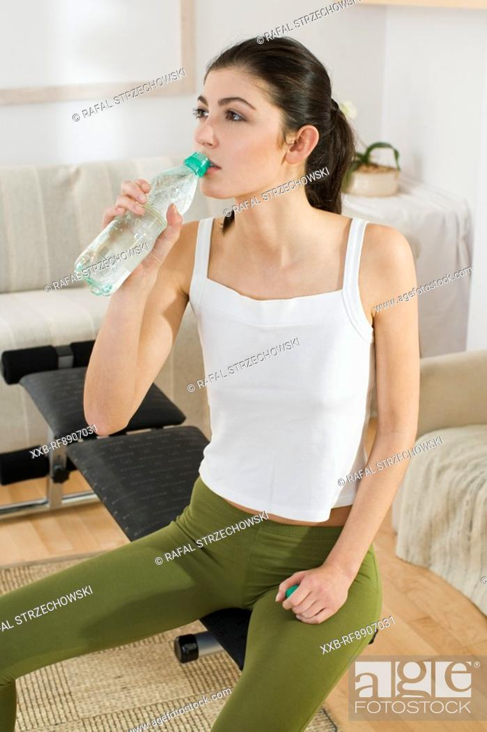 Stock Photo: young woman drinking water.