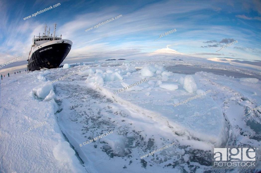 Stock Photo: Marina Svetaeva, Ice-strengthened Russian cruise ship ( Aurora Expeditions) in McMurdo Sound sea ice - volcano Mt Erebus behind- volcano Mt Erebus behind.