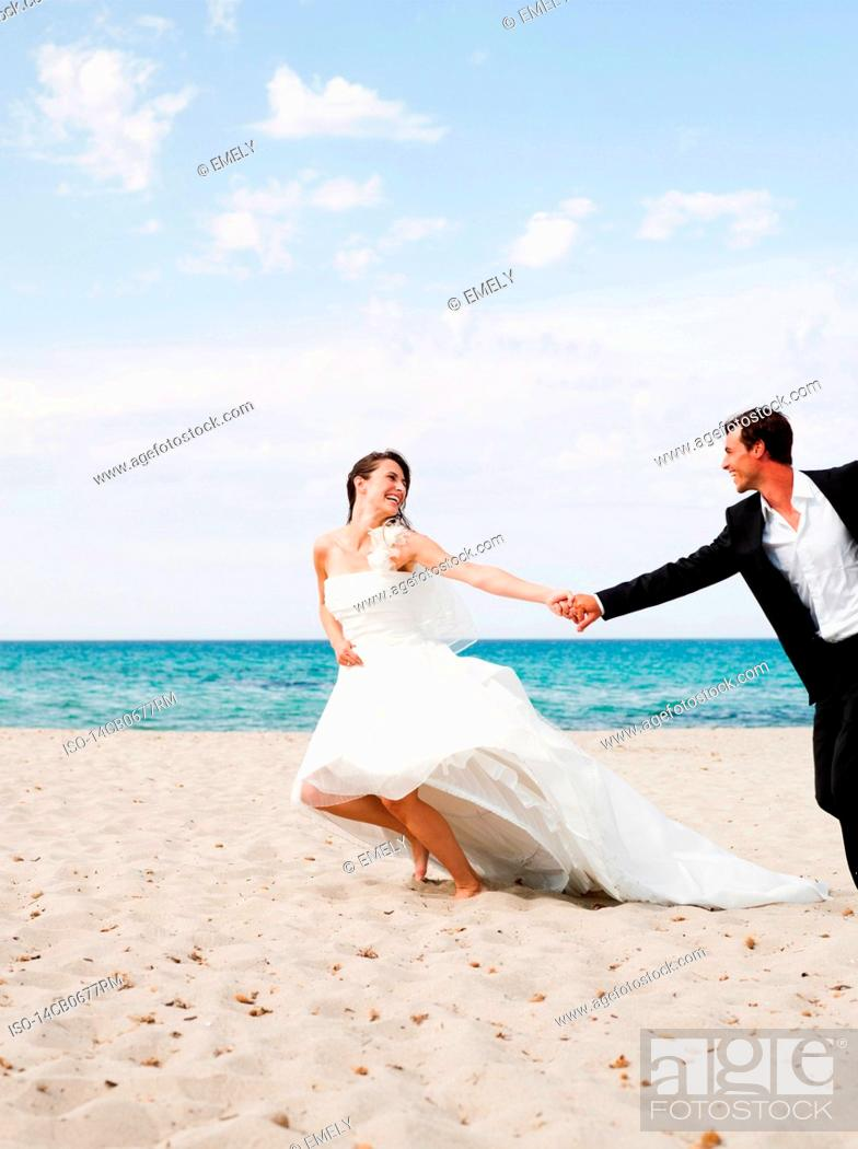 Miraculous Bride And Groom Running Along Beach Stock Photo Picture Download Free Architecture Designs Scobabritishbridgeorg