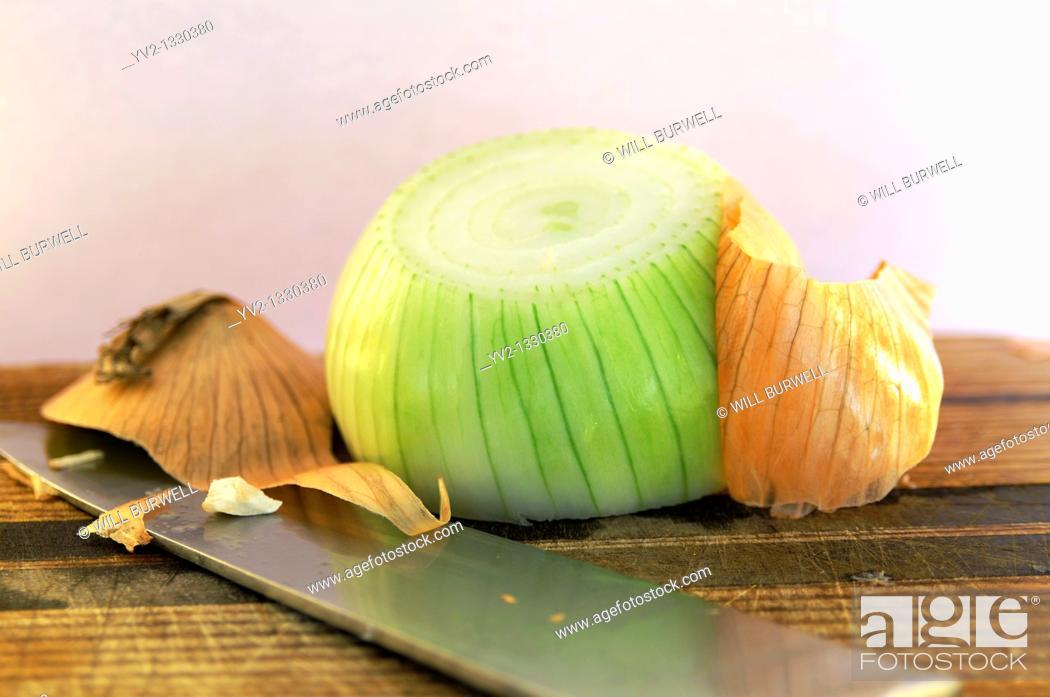 Stock Photo: peeling back the onion.