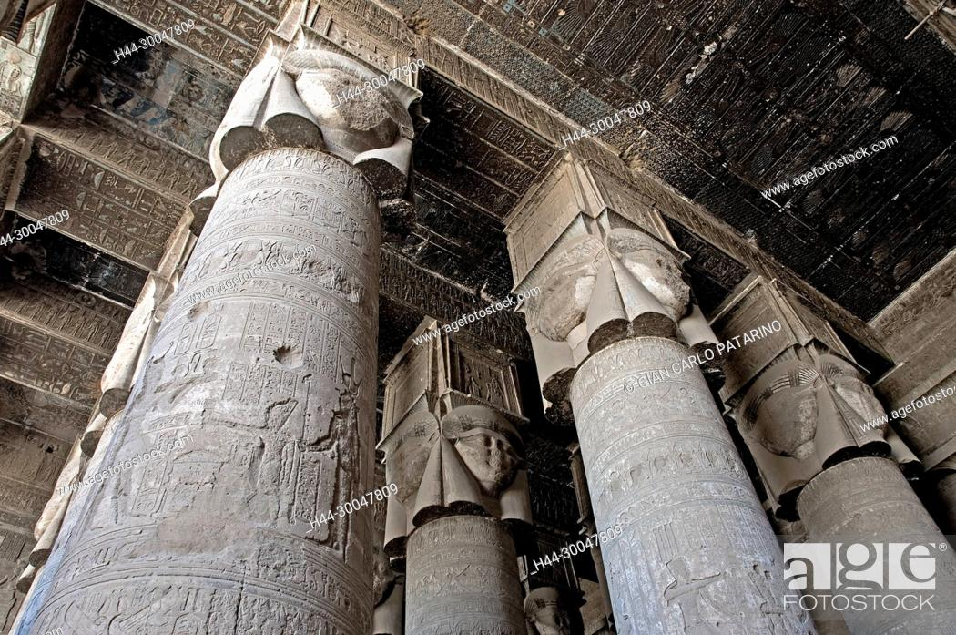 Stock Photo: Dendera Egypt, temple dedicated to the goddess Hathor.View of the hypostyle hall with columns and ceiling before cleaning.