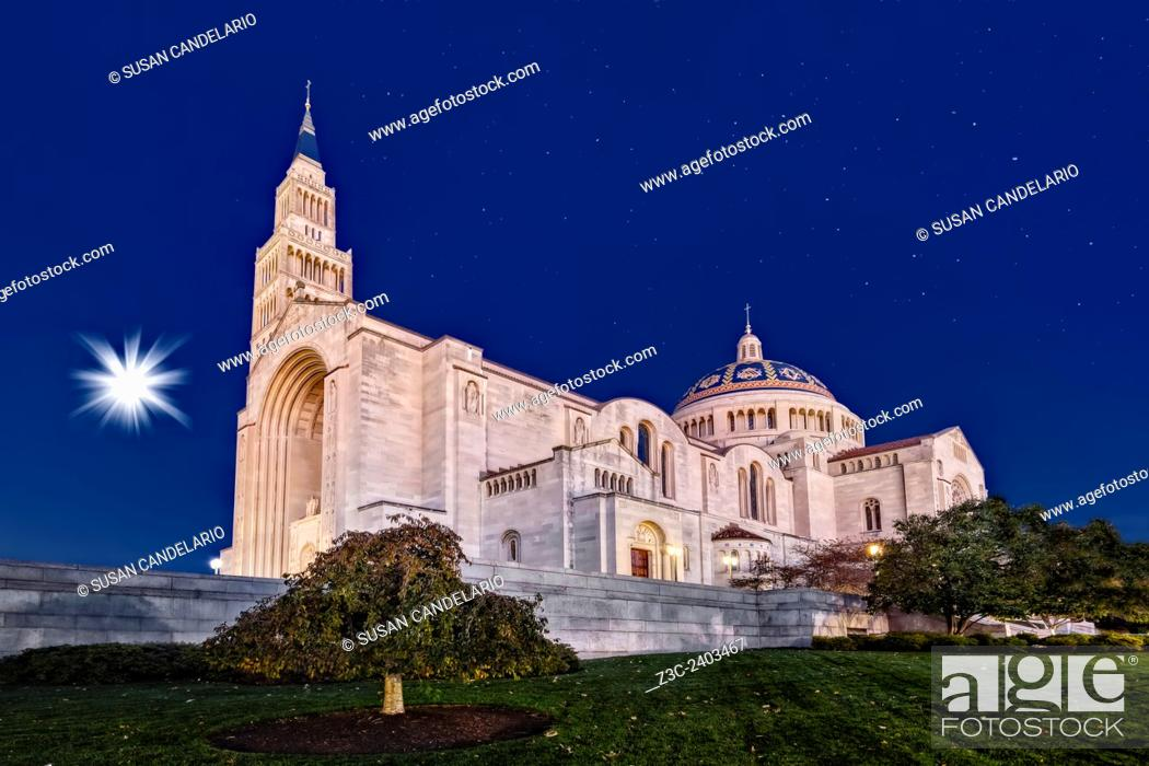 Stock Photo: Basilica of the National Shrine of the Immaculate Conception on a clear night with a wanning gibbous setting moon and a starry sky.