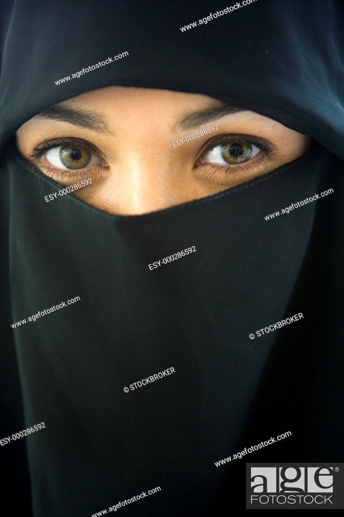 Stock Photo: Woman wearing black veil indoors.