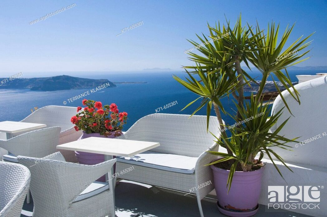 Stock Photo: Typical Greek apartment balcony furniture in Imerovigli on the Greek Island of Santorini, Greece.