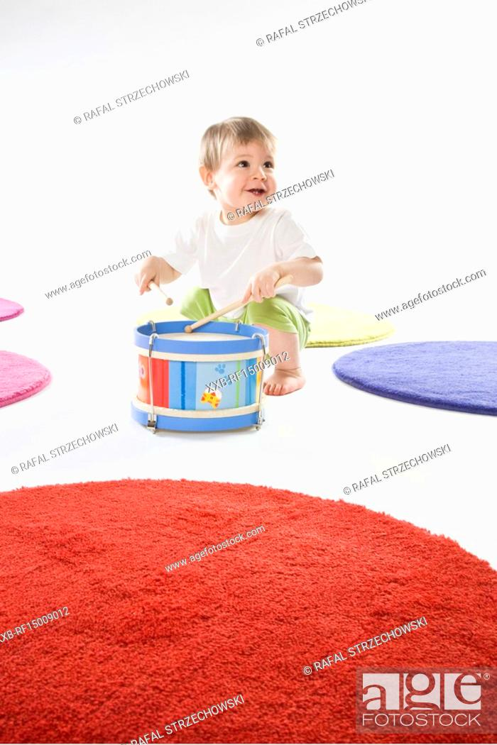 Stock Photo: baby playing on drum.
