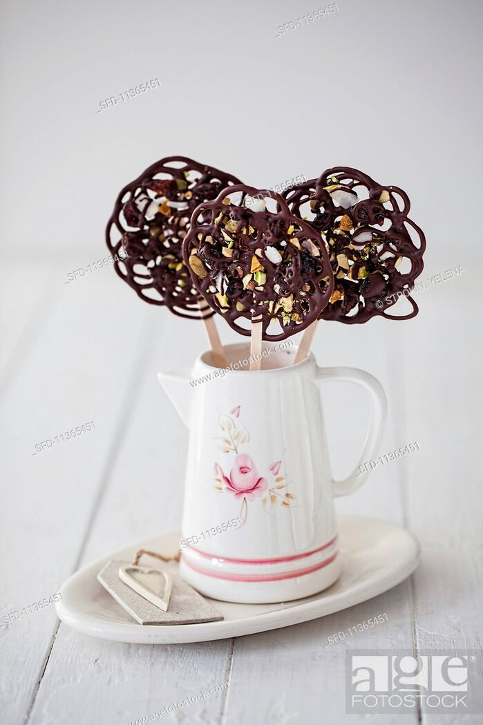 Photo de stock: Chocolate lollies with dried fruits.