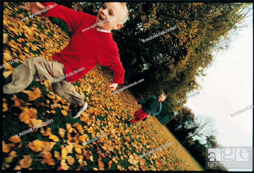 Stock Photo: kids running in a playground.