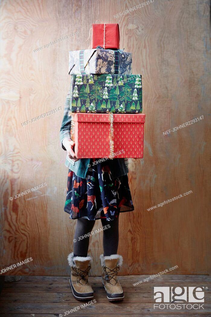 Stock Photo: Girl holding Christmas presents.