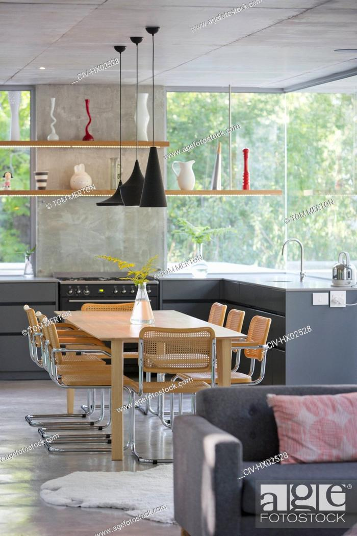 Stock Photo: Modern home showcase interior kitchen and dining table.