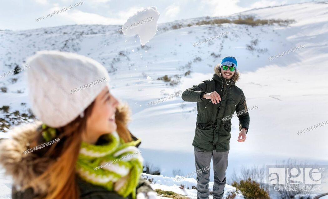 Stock Photo: Spain, Asturias, couple playing in the snow.