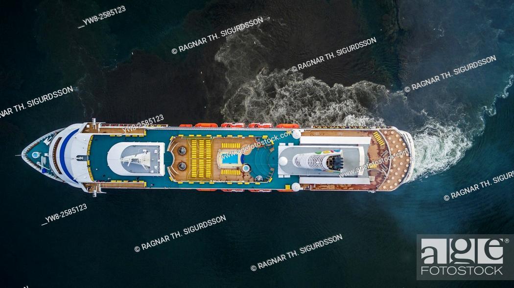 Stock Photo: AIDAcara cruise ship. AIDAcara cruise ship is part of a German fleet of ships. Image is shot with a drone. Reykjavik Harbor, Reykjavik, Iceland.