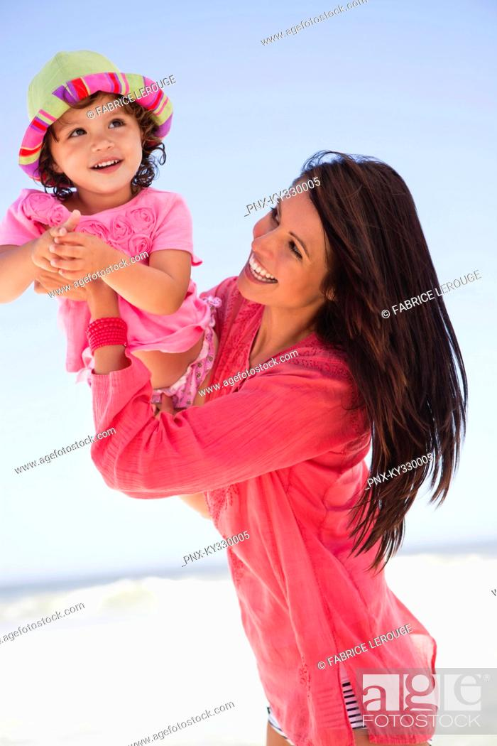 Stock Photo: Woman enjoying on the beach with her daughter.