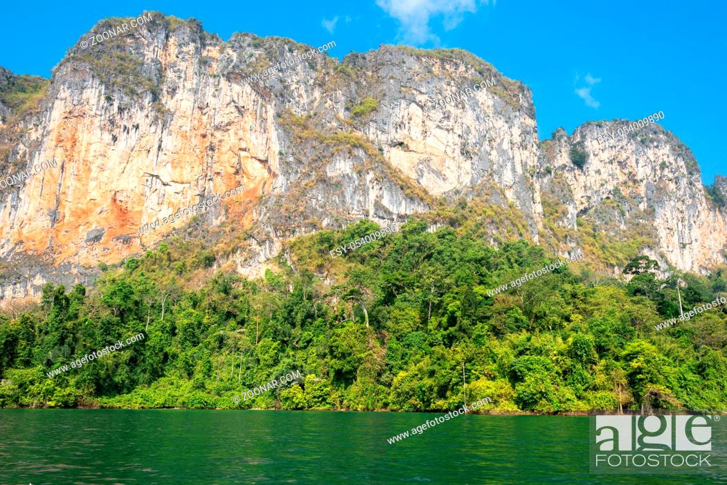 Stock Photo: The national park Khao Sok with the Cheow Lan Lake is the largest area of virgin forest in the south of Thailand. Limestone rocks.