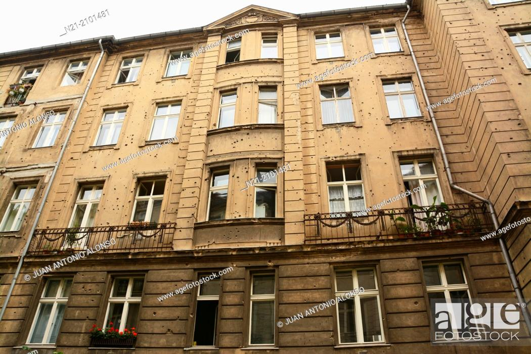 Stock Photo: Building on an off Grosse Hamburger Strasse walkway leading to the Sophienkirche. The façade of the building still shows WWII shrapnel or bullet impacts.