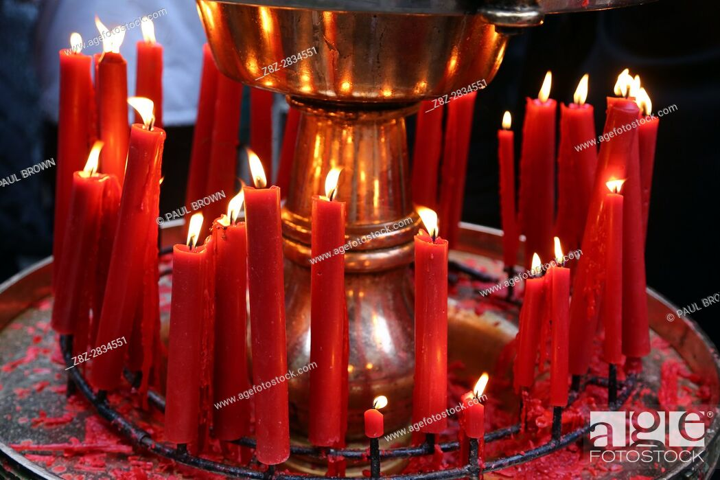 Stock Photo: Red candles burning at the Longshan Buddhist Temple at Chinese New Year in Taipei, Taiwan.
