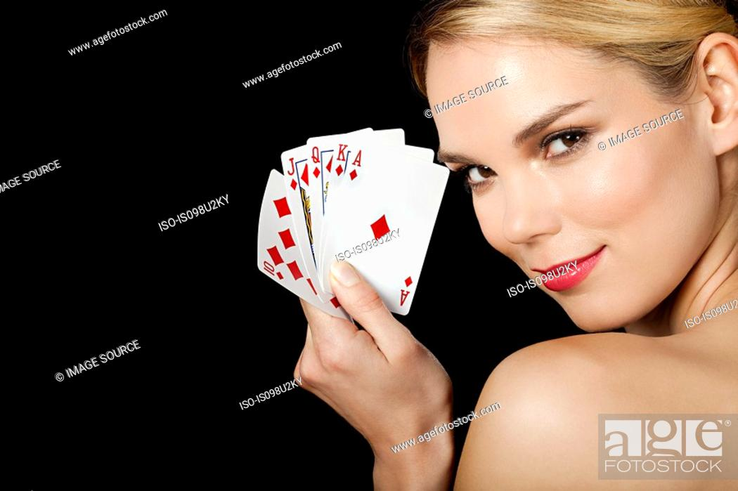Stock Photo: Young blonde woman playing cards.