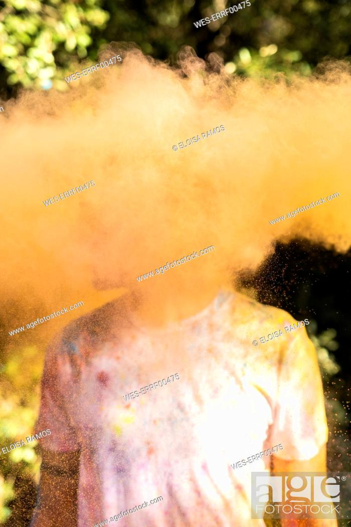 Photo de stock: Man shaking his head, full of colorful powder paint, celebrating Holi, Festival of Colors.
