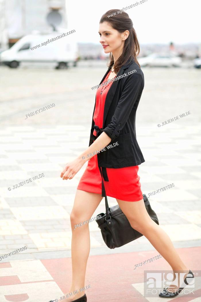 Stock Photo: Woman walking on a street.