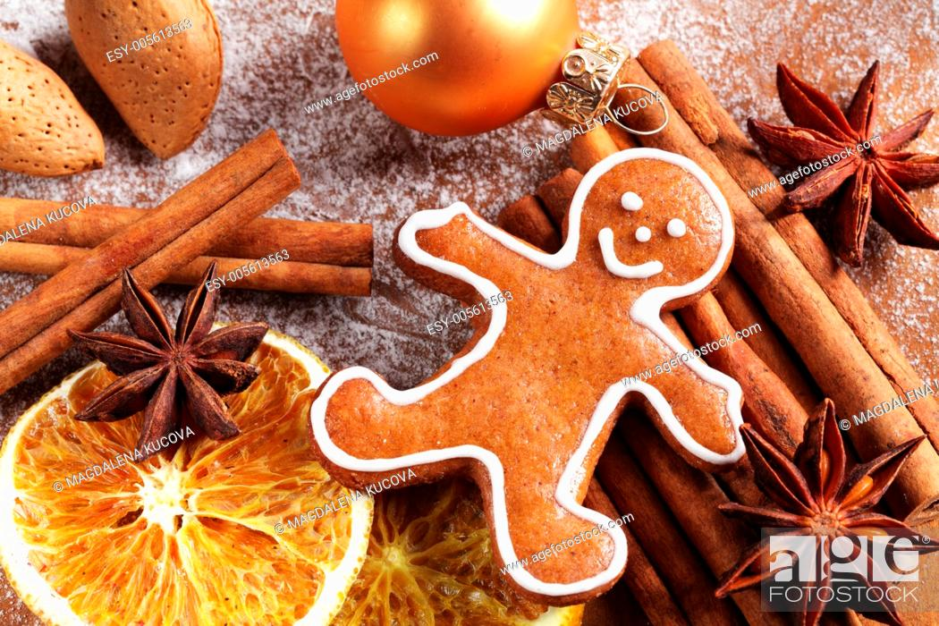 Stock Photo: Christmas gingerbread man and spices.
