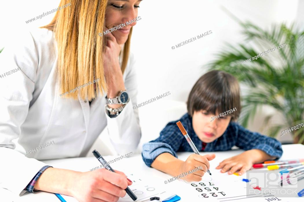 Stock Photo: Psychology test for children. Toddler undergoing a logic test with numbers.