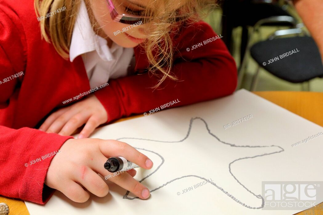 Stock Photo: Girl touching shell drawing using xxxx raised technique Mysight Nottingham.