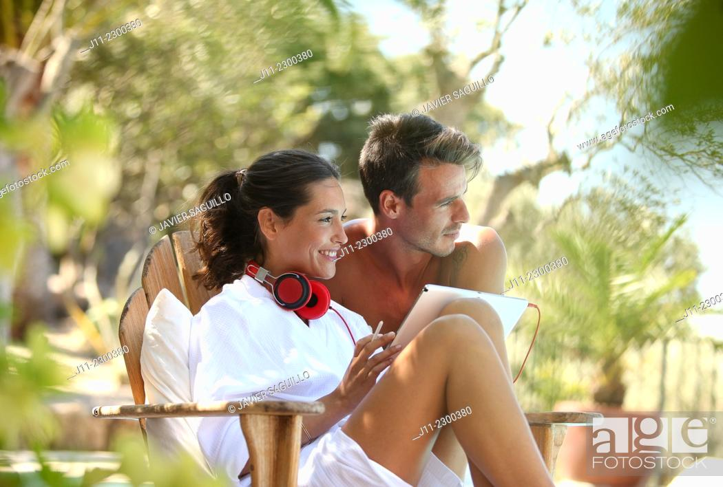 Stock Photo: Couple, digital tablet and headphones.