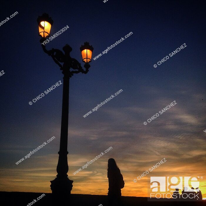 Stock Photo: An man walks at sunset in Cadiz, Andalusia, Spain.