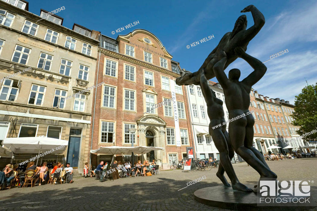 Stock Photo: Modern sculpture group on Gammel Strand. Cafes background, Copenhagen, Denmark.