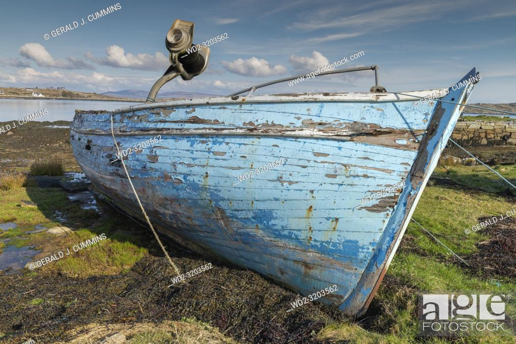 Stock Photo: Old, derelict wooden fishing boat, left to rot on Irish coastline.