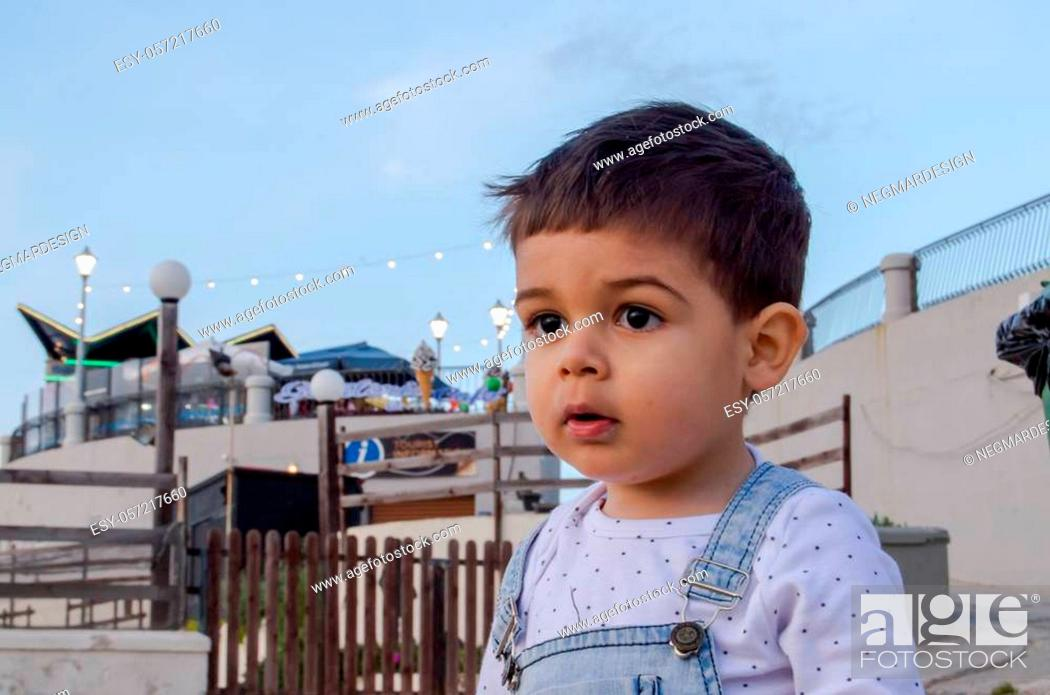Stock Photo: Portrait of cute two years old boy dark hear sky showing.