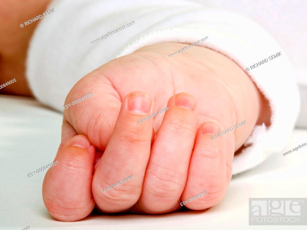 Stock Photo: baby''s hand.