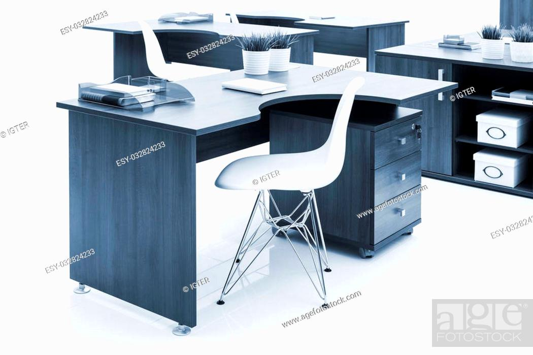 Stock Photo: wooden desks and white plastic armchairs in the office.