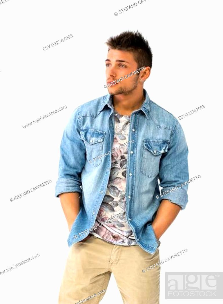 Stock Photo: Handsome young man standing with open denim shirt.