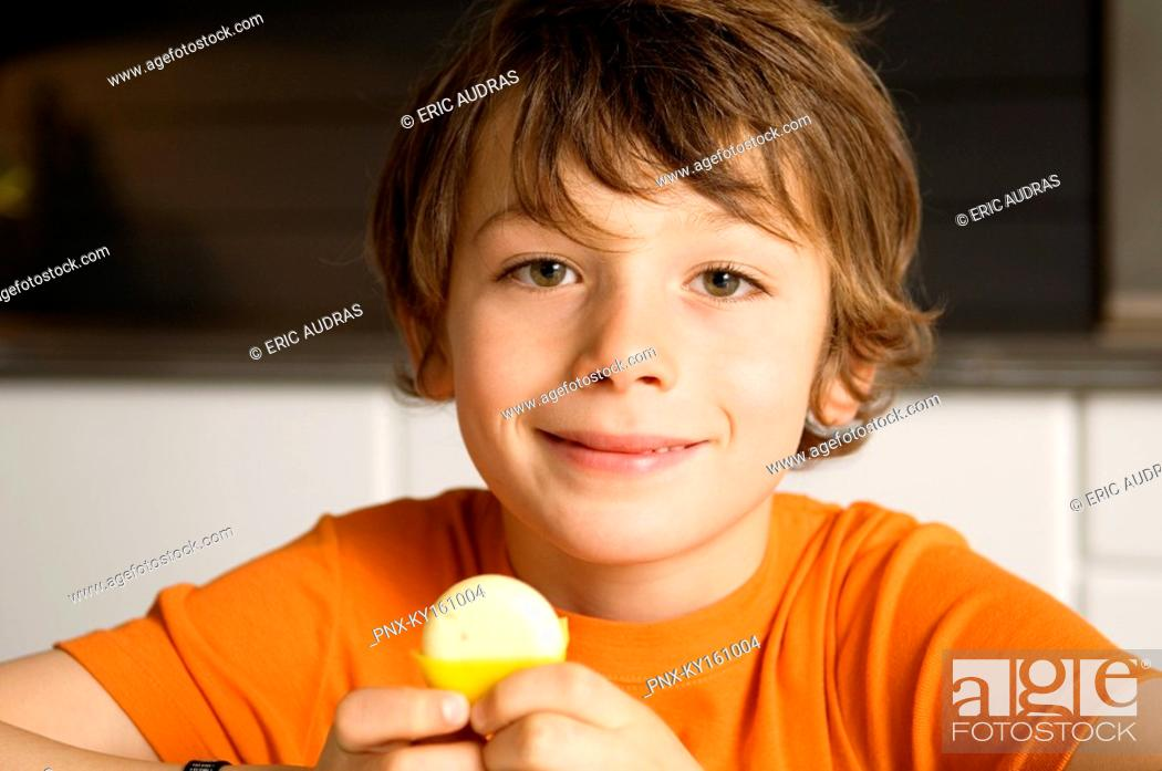 Stock Photo: Portrait of a boy holding cheese.