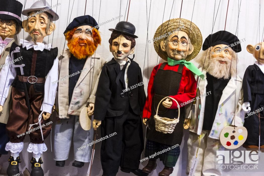 Stock Photo: Puppets inside a puppet shop in Prague, The Czech Republic.