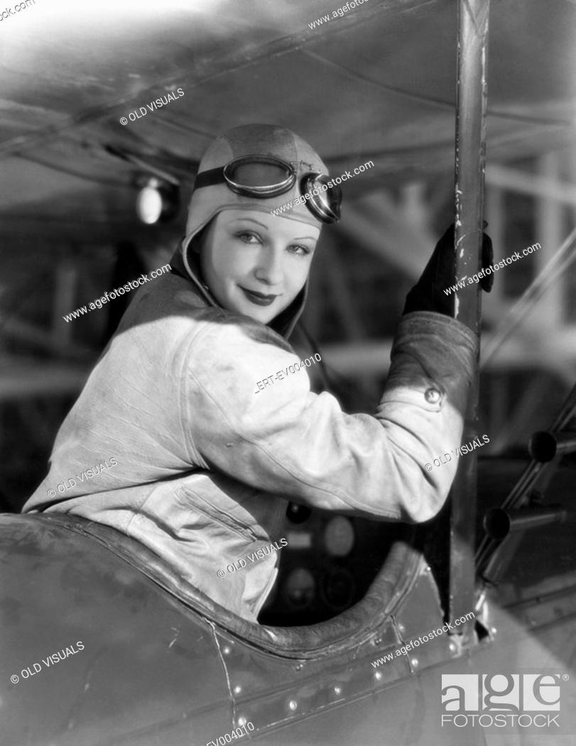 Stock Photo: Portrait of female pilot All persons depicted are not longer living and no estate exists Supplier warranties that there will be no model release issues.