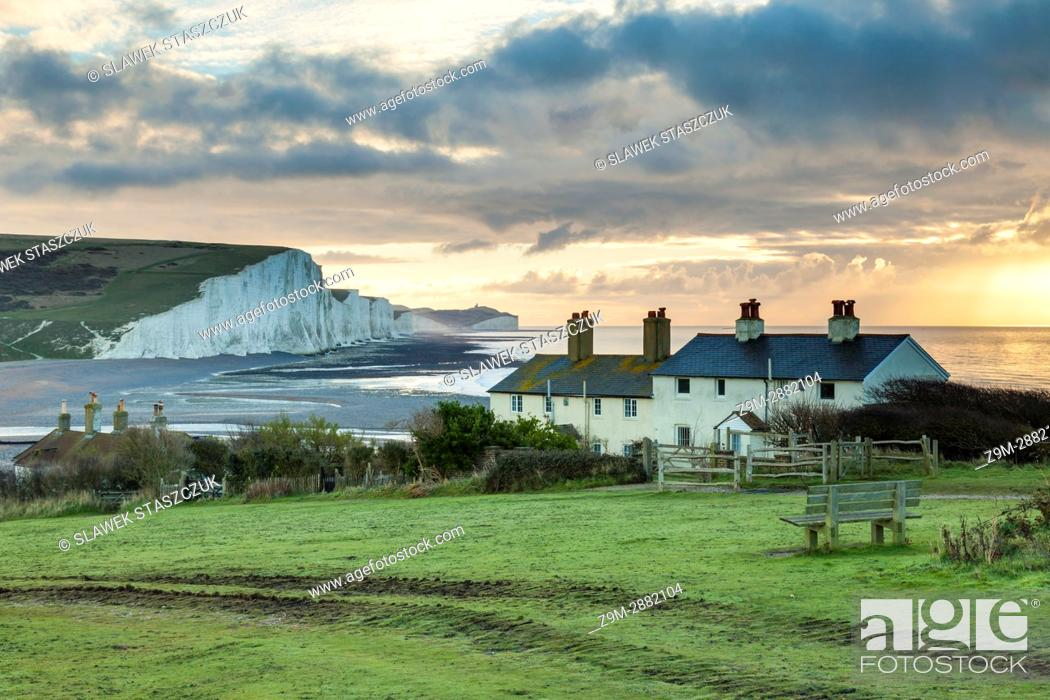 Stock Photo: Sunrise at Coastguard Cottages in East Sussex, England. Seven Sisters cliffs in the distance.