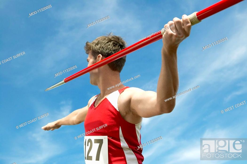 Stock Photo: Athlete about to throw javelin half length.