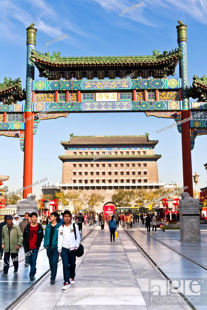 Stock Photo: Archery tower, Qianmen Gate, behind colorful arch, Qianmen Street, Beijing, China.