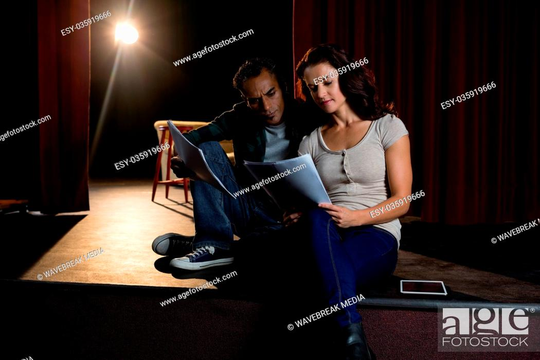 Stock Photo: Actors reading their scripts on stage.
